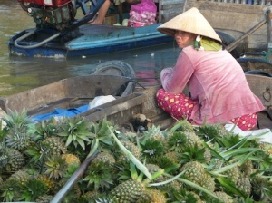 Floating market pineapple vendor